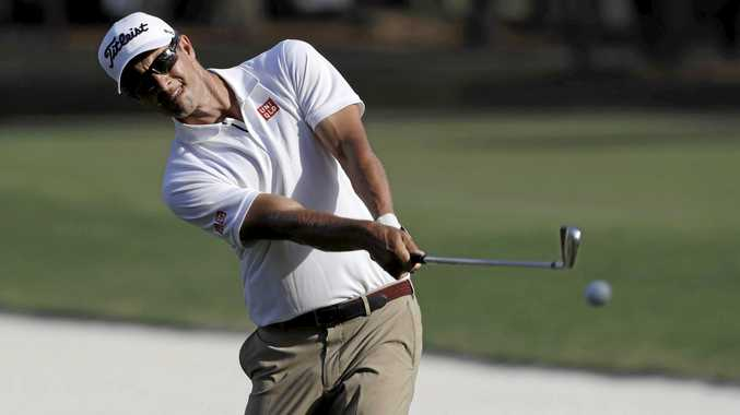 Adam Scott, of Australia, hits from the rough on the 15th fairway during the first round of the Players Championship.