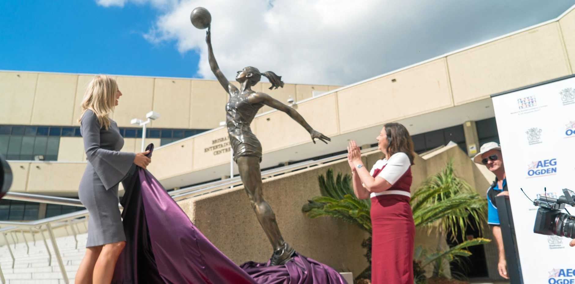 Netballer Laura Geitz and Premier Annastacia Palaszczuk unveil the 2.6 metre statue of Laura in full flight outside the Brisbane Entertainment Centre in Boondall.