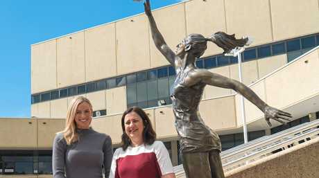 Netballer Laura Geitz and Premier Annastacia Palaszczuk at the unveiling of the statue of Laura outside the Brisbane Entertainment Centre in Boondall. In the background you can see the statue of basketballer Leroy Loggins at the opposite side of the steps.