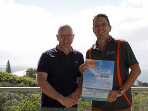THE RISE AND RISE: Mark Beech from Rainbow Ocean Palms Resort and Heatley Gilmore from Rainbow Getaway Holiday Apartments announce Rainbow Beach's publication for New Zealand, called Visit Rainbow Beach.