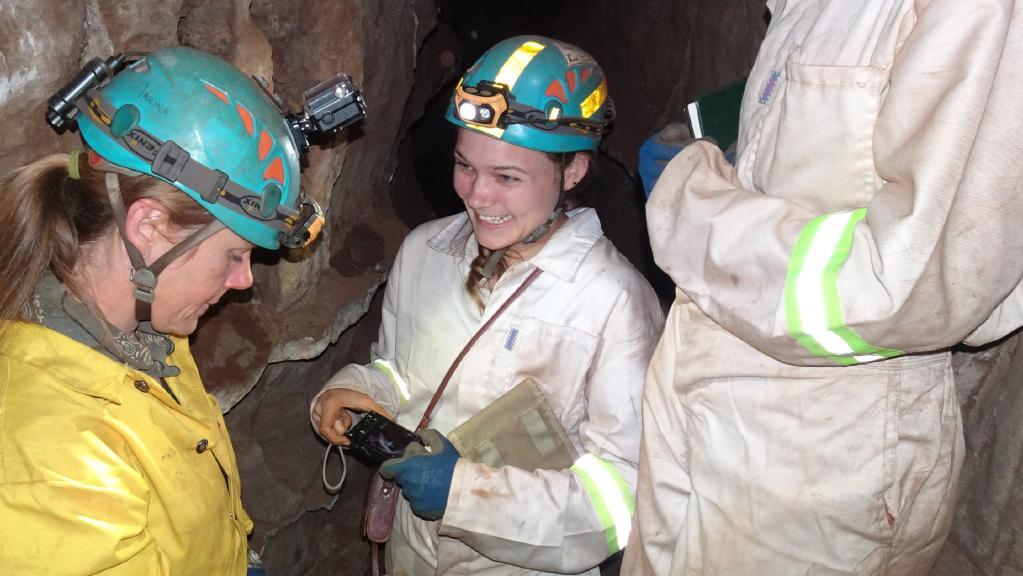 Hannah Hilbert-Wolf (centre) from the JCU team finds a new naledi fossil.