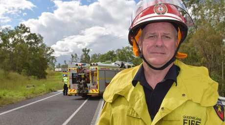 FATAL CRASH: QFES Inspector Ronald Higgins at the scene of a two-vehicle collision.Photo Jim Alouat / NewsMail