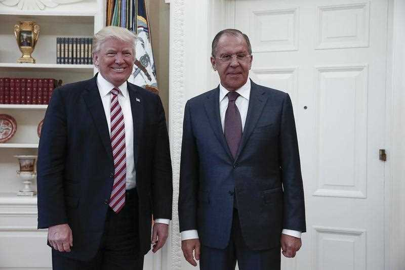 US President Donald J. Trump (L) posing with Russian Foreign Minister Sergei Lavrov (R) during their meeting in the White House in Washington, DC, USA, 10 May 2017