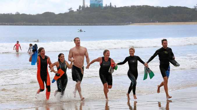 FINISH LINE: Teachers from Nambour Special School's Wahoo 2 team take on the Island Charity Swim 2017.