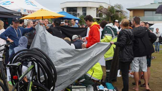 A competitor was assisted by paramedics at the Byron Bay Triathlon.