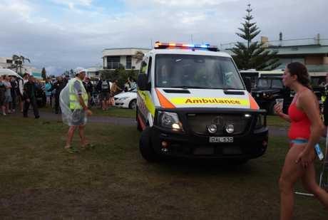 Paramedics rush to help a competitor at the Byron Bay Triathlon.