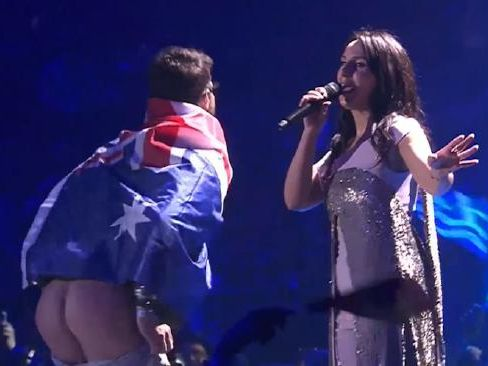 Man wrapped in Aussie flag jumps onstage and moons Eurovision audience
