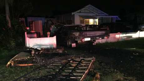 RUINS: What was left of mattresses which were set alight on the back of a ute in Eiser St in Harristown Saturday night.