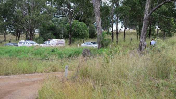 Police at the scene where a body has been found near Tarampa.