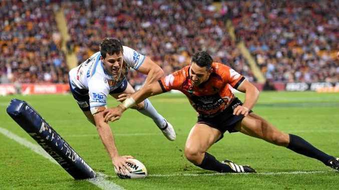Storm player Billy Slater fails to stop Titans player Anthony Don scoring a try. Photo: AAP