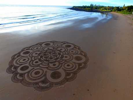 BEACH ART: Peter Dinham left a message on the sand for Mother's Day.