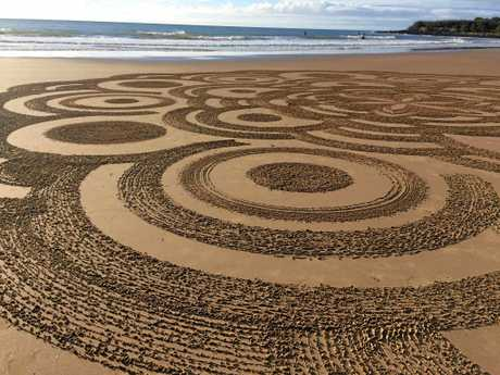 HAND MADE: Peter Dinham doesn't plan his sand art, which he makes using a rake.