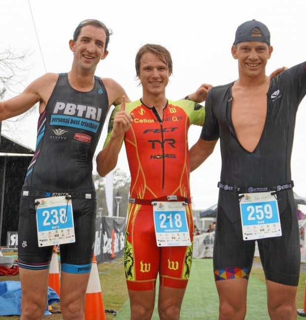 Nick Hill, Josh Amberger (winner) and Matt Slee after the open men's finish at the Byron Bay triathlon