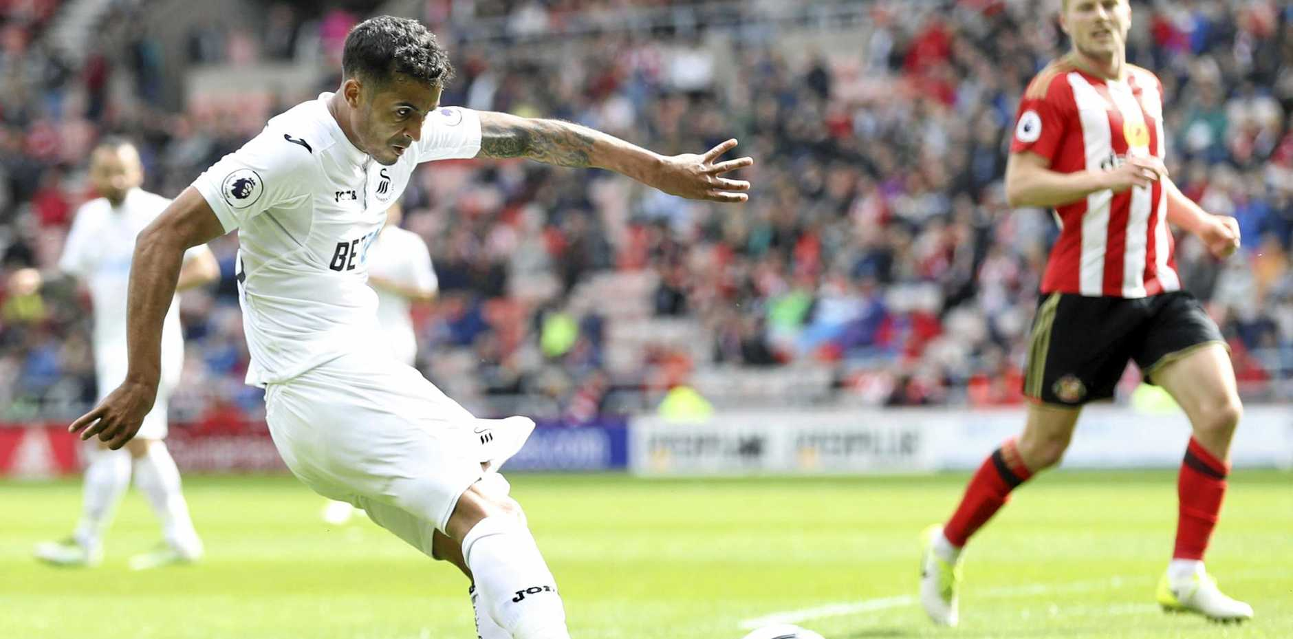 Swansea City's Kyle Naughton scores his side's second goal in the 2-0 win at Sunderland.