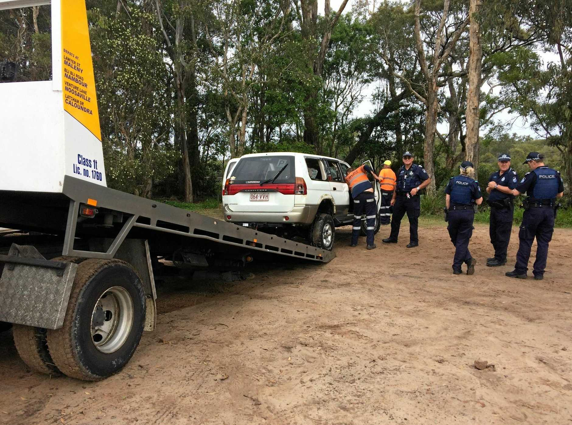 A car found on its roof in the Mooloolah River at Parrearra.