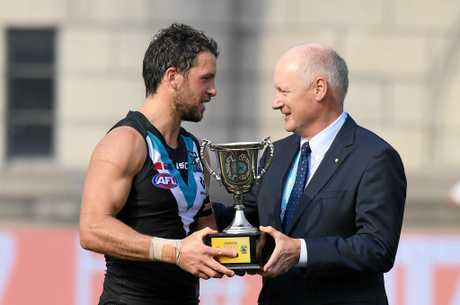 Travis Boak of the Power (left) is presented the Shanghai Cup by the AFL Chairman Richard Goyder