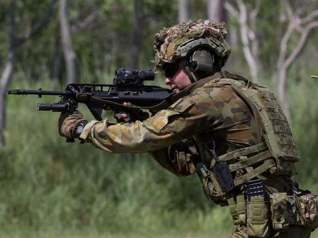 Australian Army officer Lieutenant Andrew Davis from 3rd Battalion, Royal Australian Regiment, takes aim on the combat marksmanship range at Mount Stuart military training area on March 7, 2017.