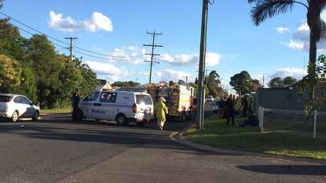 Emergency services at the scene after a car hit a pedestrian in Darling Heights.