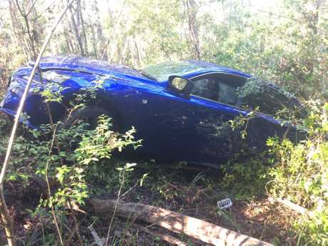 ABANDONED CAR: A blue Lexus lies abandoned at the foot of a cliff in Glenview.