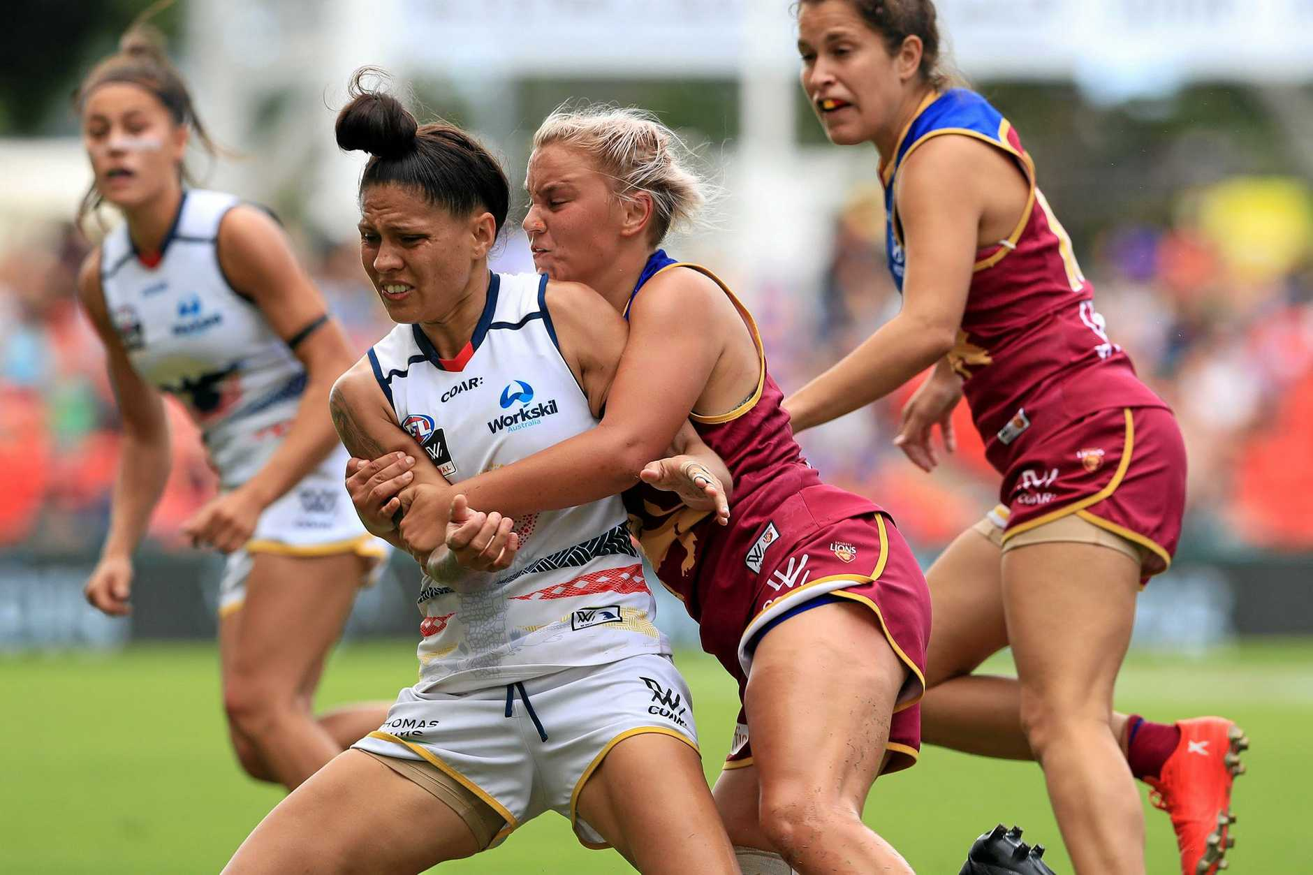 TALENT: Megan Hunt tackles Adelaide Crow Stevie Lee-Thompson during the AFLW grand final between the Brisbane Lions and Adelaide Crows.
