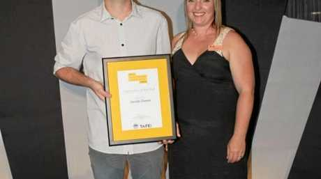Jacob Owen pictured with Alicia Bales, TAFE NSW North Coast Director of Industry Services.