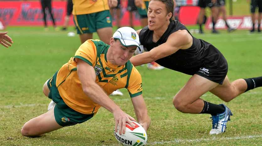 TOUCH DOWN: Australia's Tim Glazebrook dives to score a try during the mixed match against New Zealand at Sunshine Coast Stadium on Sunday.