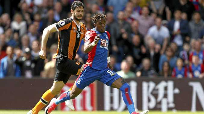 Crystal Palace's Wilfried Zaha scores his side's first goal in the 4-0 EPL win over Hull City.