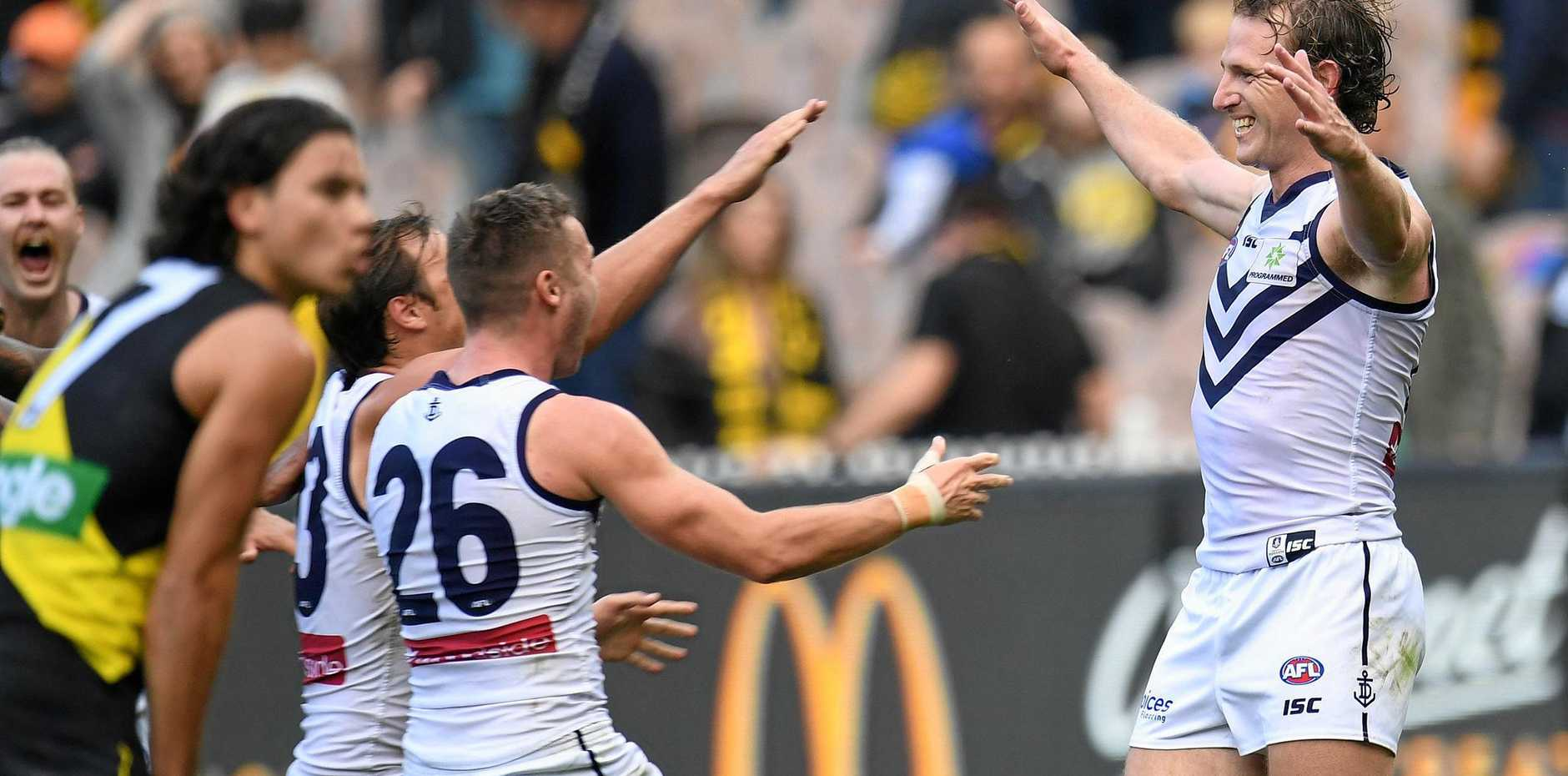 David Mundy (right) celebrates kicking the winning goal after the siren against Richmond.