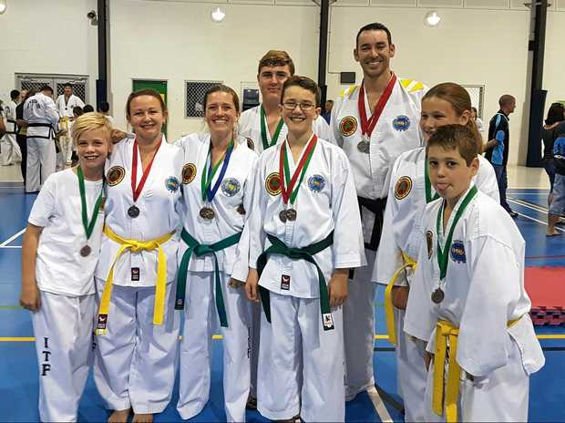 Local Taekwon-Do students returned to the Bay with 17 medals in hand after national championships. Bailey Shaw, Tina Bounds, Gaby Whitley, Zach Dirston, Kevin Whitley, Craig Whitley, Emerald Dale and Lawson Dale.