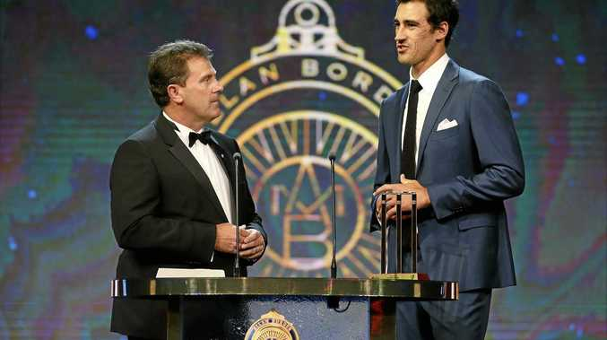 Mark Taylor speaks with Mitchell Starc  during the 2017 Allan Border Medal
