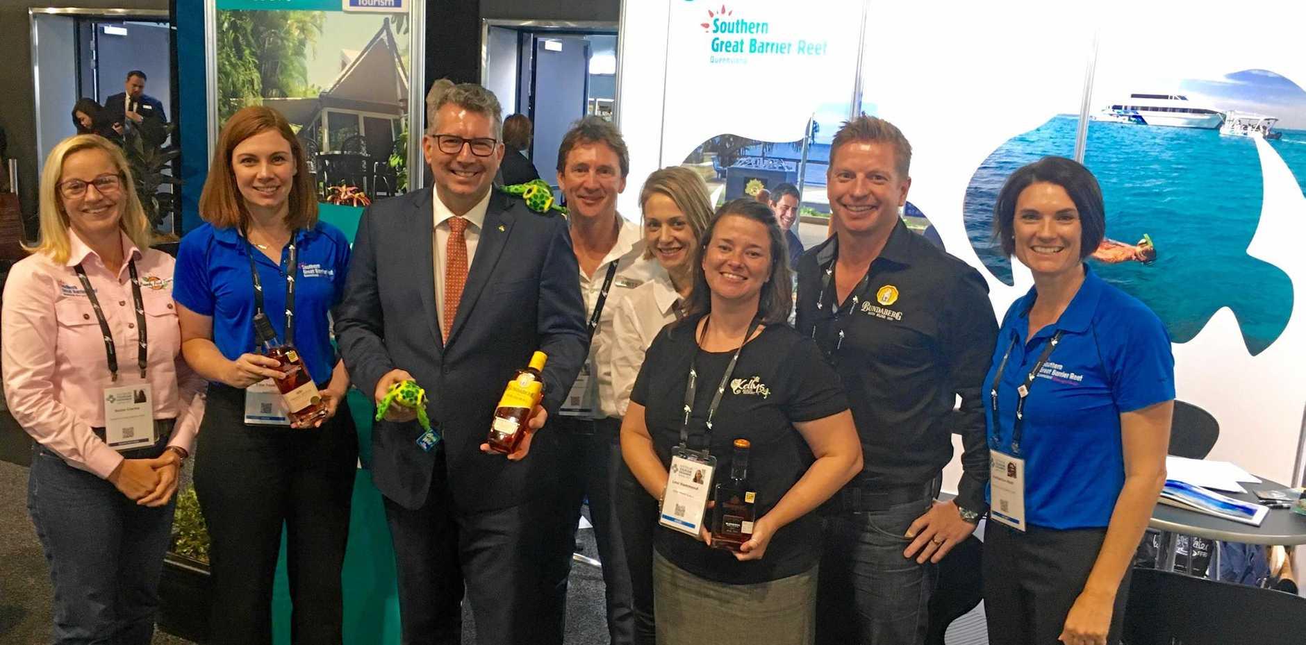 TEAM BUNDY: Suzie Clarke, Ellie Tonkin, Keith Pitt, Brett Lakey, Penny Morgan, Loni Hammond, Duncan Littler and Katherine Reid at the Australian Tourism Exchange today.