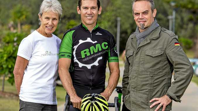 ON TRACK: Cyclist Robbie McEwen has thrown his support behind the proposed rail trail from Murwillumbah to Casino.   Pictured here with Northern Rivers Rail Trail supporters Marie Lawton and Duncan Gibbs.