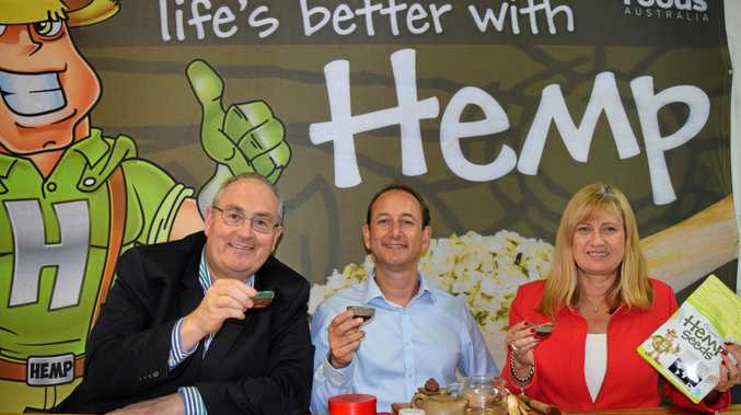 Shadow Minister for Health Walt Secord, HFA CEO Paul Benhaim and Richmond MP Justine Elliot taste hemp products over a discussion of the industry.
