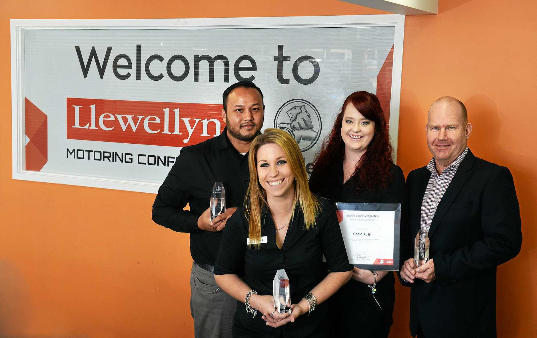 AHEAD OF THE PACK: Llewellyn Holden Service advisors Owen Ngwun, Chaia Kuss and Amy Graham and service manager Adam Jeffery celebrate winning first place service centre in Queensland.