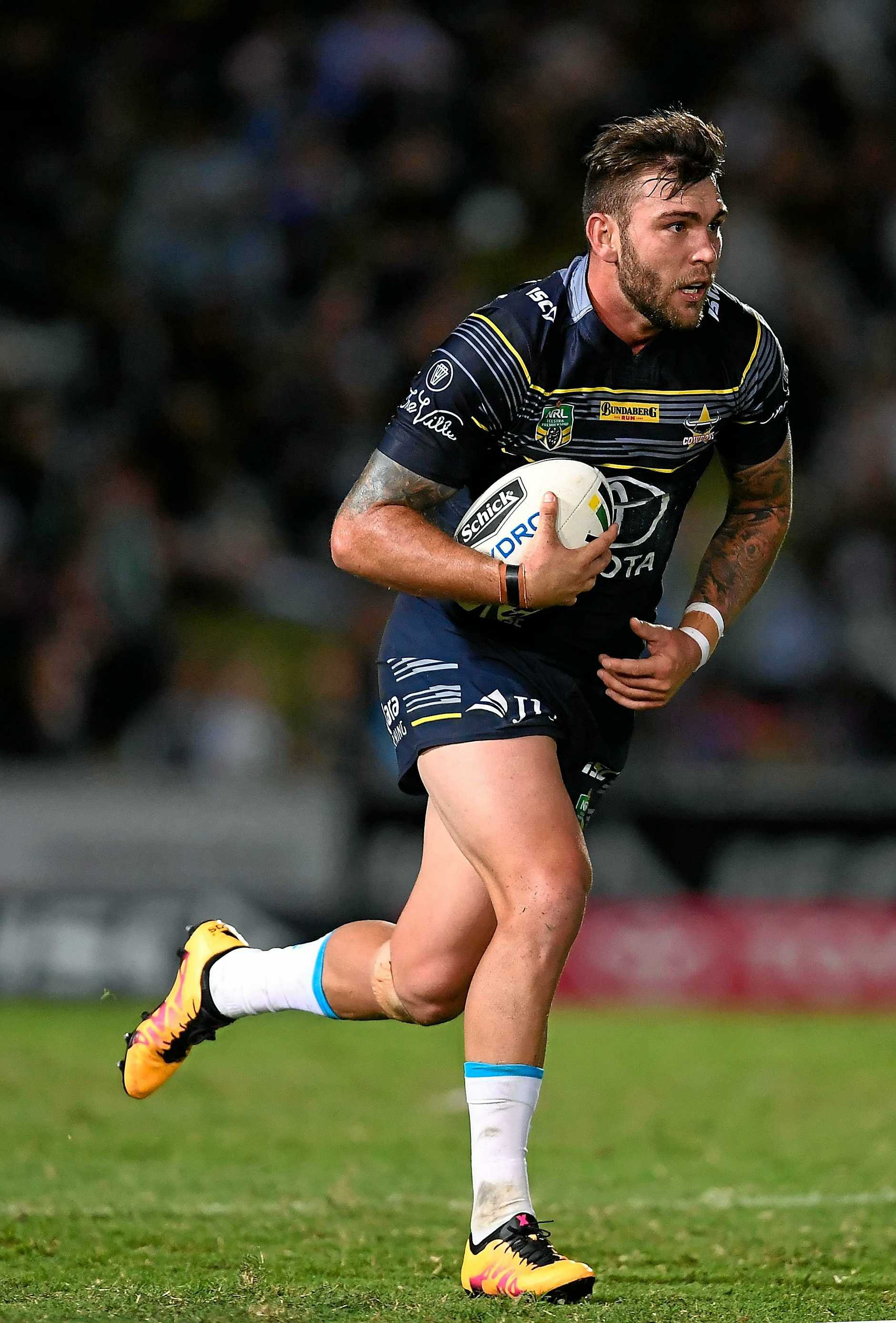 Kyle Feldt on the run for the Cowboys.