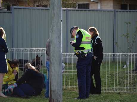 Police at the scene of an incident involving a child and a car in Darling Heights.
