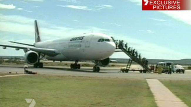 Ordeal: Passengers leave the aircraft at Learmonth.