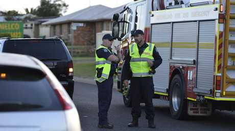 Police investigate the scene of a incident where a young girl has been taken to hospital with injuries after she was struck by a car in Darling Heights, Monday, May 15, 2017.