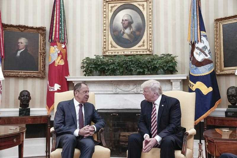 A handout photo made available by the Russian Foreign Ministry shows US President Donald J. Trump (R) speaking with Russian Foreign Minister Sergei Lavrov (L) during their meeting in the White House in Washington, DC, USA, 10 May 2017