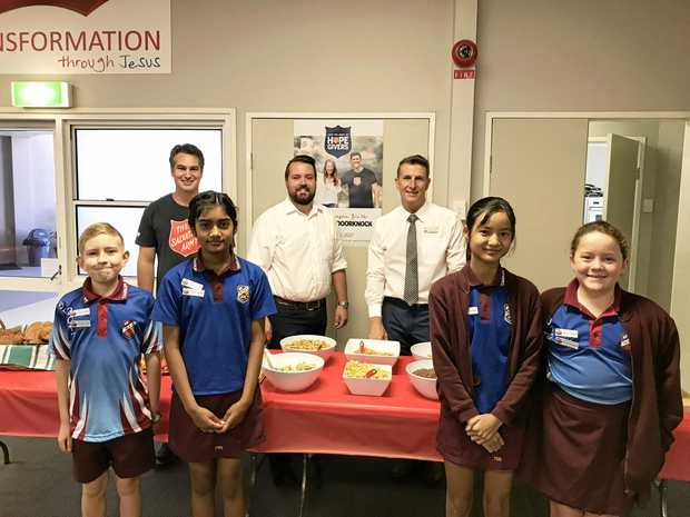 Attending the recent Salvation Army Red Shield Appeal launch breakfast for schools are (front) Taigum State School captains Lincoln Fisher, Stacey George, Poe Mi Paw and Tahlia Stewart with (back) Steve Unicomb from The Salvation Army, Deagon Ward Councillor Jared Cassidy and Taigum State School principal Mark Fisher.