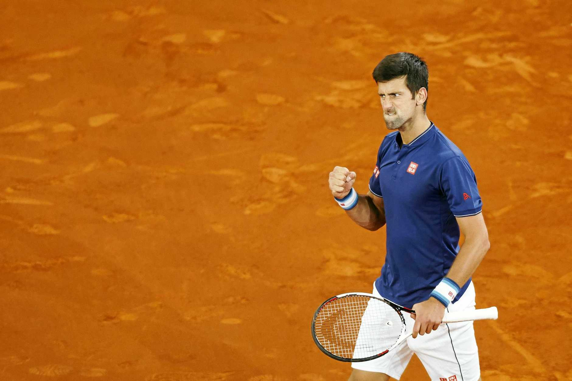 Novak Djokovic from Serbia reacts after winning a point against Feliciano Lopez during a Madrid Open tennis tournament match in Madrid, Spain, Thursday, May 11, 2017 . (AP Photo/Daniel Ochoa de Olza)
