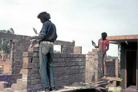 Lindsay (left) brick laying at Jay Creek.