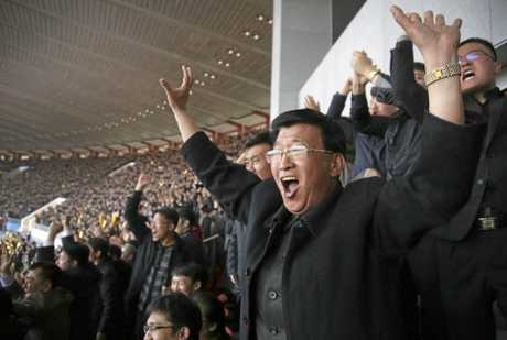 North Koreans cheer after their women's soccer team scored their first goal against South Korea in a qualifying match for the Asian Football Confederation Cup at the Kim Il Sung Stadium in Pyongyang last month.