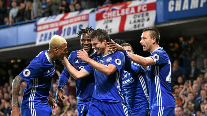 Cesar Azpilicueta (centre) of Chelsea celebrates scoring with teammates.