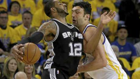 San Antonio Spurs forward LaMarcus Aldridge (12) drives against Golden State Warriors center Zaza Pachulia