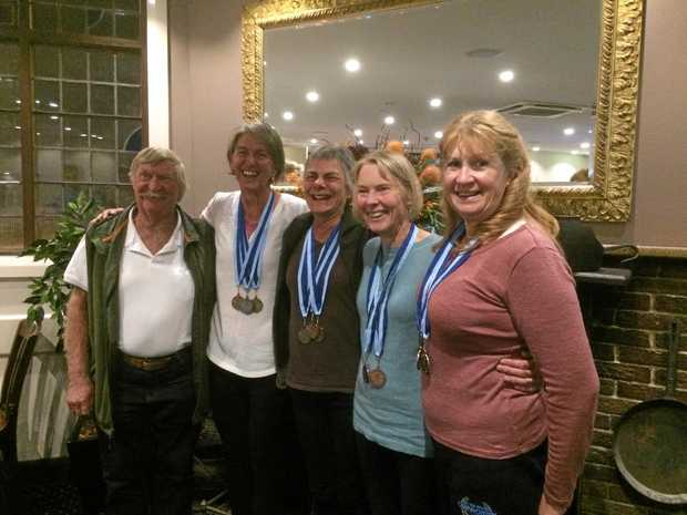 MEDAL HAUL: David Hailes, Keryn Saunders, Mandy Steel, Clare Millist and Joanne Meehan celebrate their recent rowing success.