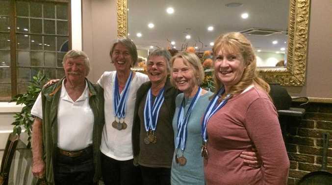 MEDAL HAUL: David Hailes, Keryn Saunders, Mandy Steel, Clare Millist and Joanne Meehan celebrate their recent rowing success.