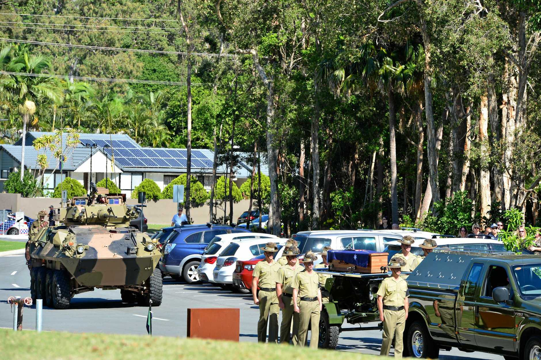 Trooper Stuart Reddan's coffin followed by an armoured vehicle go towards the funeral service.