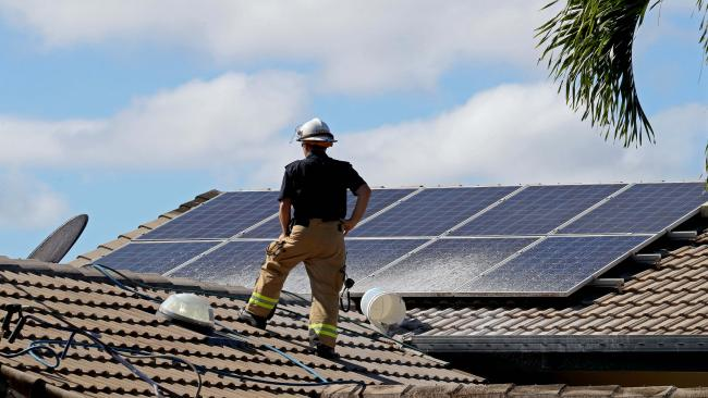Firefighters inspect the roof of a Mooroobool house which sustained damage after cleaners using chlorine likely created a chemical reaction which caused an explosion in Olfersia Ct. Neighbour Monica Stapleton heard the blasts. Picture: Marc McCormack