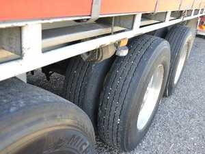 Truck trailer lying across Bruce Highway